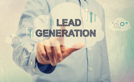 Young man in blue shirt pointing at Lead Generation Stock Photo