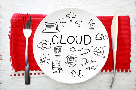 napkins: Cloud concept on white plate with fork and knife on red napkins Stock Photo
