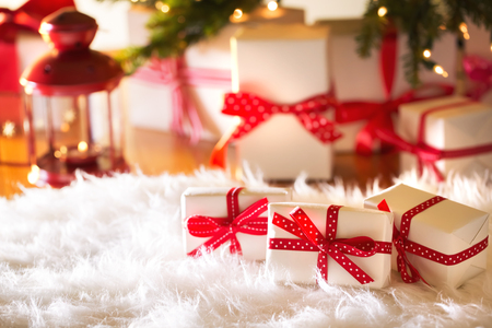 fluffy: Christmas gift boxes on a white carpet at night