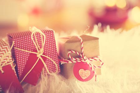samll: Small Christmas gift boxes on white carpet at night