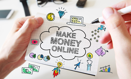 Mans hand drawing Make Money Online concept on white notebook Stock Photo