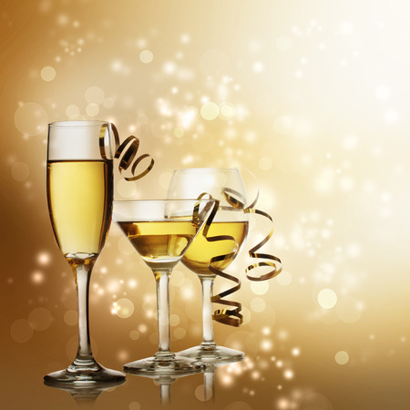 ribbon: Assorted Wine, Champagne and Cocktail Glasses on a Sparkling Gold  Backdrop Stock Photo