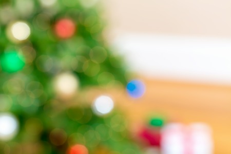 light green wall: Defocused Christmas tree and gift boxes abstract background