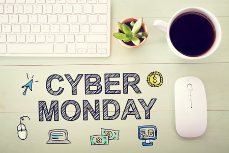 workstation: Cyber Monday message with workstation on a light wooden desk