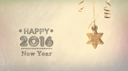 star ornament: Happy New Year 2016 message with a hanging star ornament