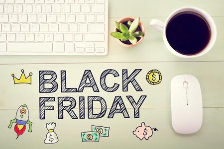 workstation: Black Friday message with workstation on a wooden desk