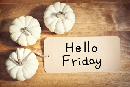 good friday: Hello Friday message with small white pumpkins on wooden table