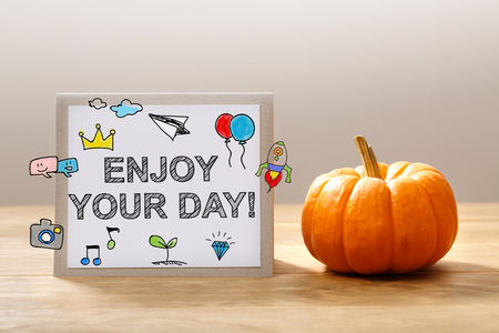 drawing paper: Enjoy Your Day message with a orange small pumpkin