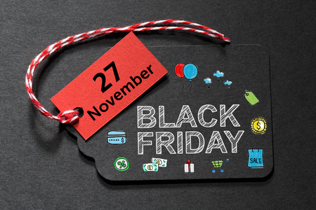 twine: Black Friday November 27 text on a black tag with a red and white twine