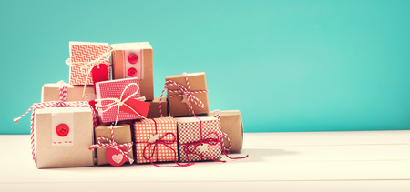 winter celebration: Collection of little handmade gift boxes on blue background