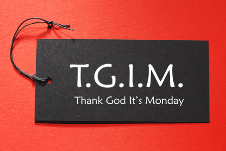 it's: TGIM text on a black tag on a red paper background