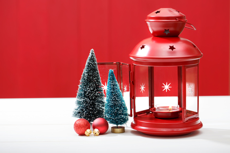 christmas trees: Christmas red lantern with miniature trees and baubles