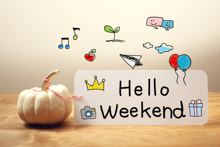 fun day: Hello Weekend message with a white small pumpkin