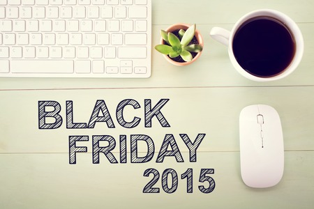 workstation: Black Friday 2015 text with workstation on a light green wooden desk Stock Photo
