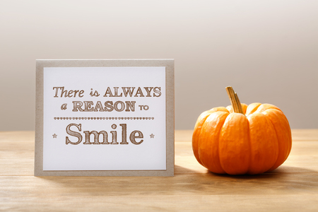 reasons: There is a always reasons to smile message with a orange small pumpkin