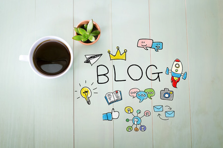 Blog concept with a cup of coffee on a pastel green wooden table