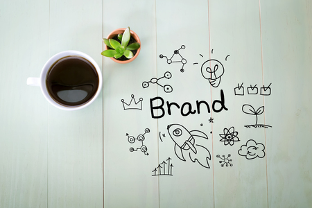 business ideas: Brand concept with a cup of coffee on a pastel green wooden table Stock Photo