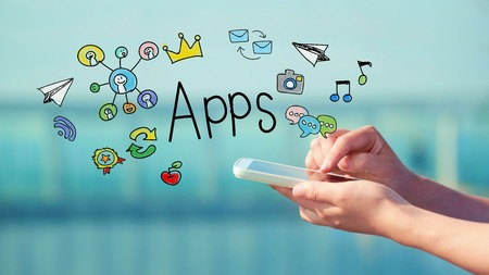 mobile application: Apps concept with person holding a smartphone