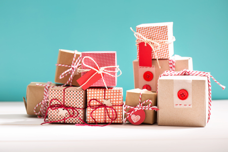 heap: Collection of little handmade gift boxes on blue background