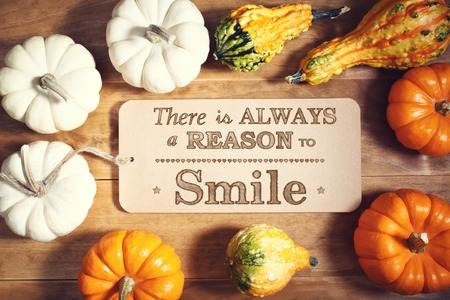 always: There is Always a Reason to Smile message with colorful pumpkins and squashes