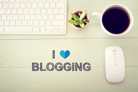 love strategy: I Love Blogging concept with workstation on a light green wooden desk Stock Photo