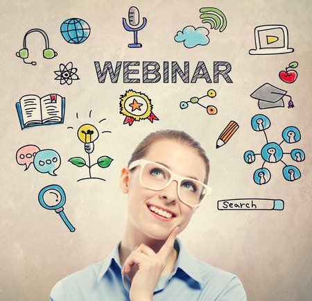 business woman: Webinar concept with young business woman wearing white eyeglasses