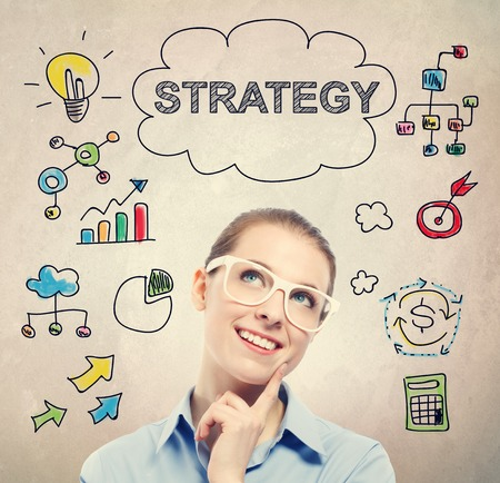 strategies: Strategy concept with young business woman wearing white eyeglasses Stock Photo