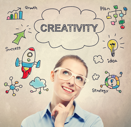 creativity concept: Creativity concept with young business woman wearing white eyeglasses