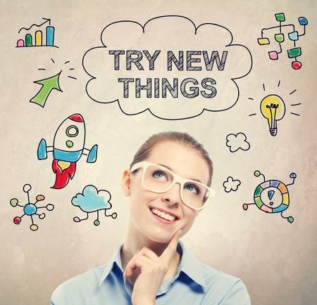 try: Try New Things concept with young business woman wearing white eyeglasses Stock Photo
