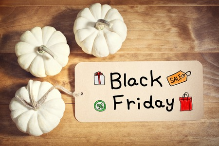 black: Black Friday message with a orange small pumpkin Stock Photo