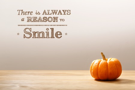 wall decor: There is Always a Reason to Smile message with a orange small pumpkin