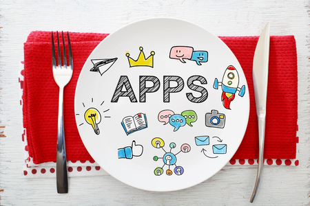 napkins: Apps concept on white plate with fork and knife on red napkins Stock Photo