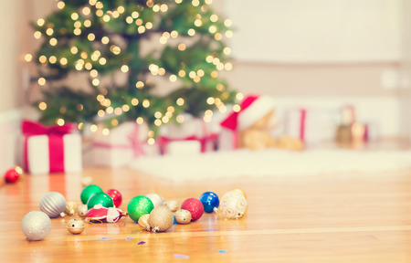 wood floor: Christmas tree and Christmas ornaments on floor