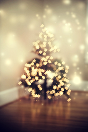 Blurred star shaped lights on a Christmas tree Stock Photo