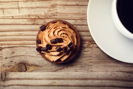 coffee and cake: Mousse cake on a rustic wooden table with coffee