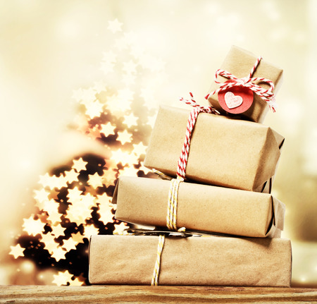 star shaped: Handmade gift boxes with star shaped lights on Christmas tree Stock Photo