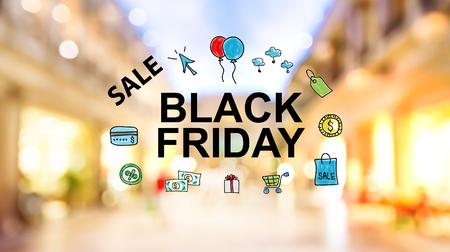 Black Friday tekst op onscherpe verlichte shopping mall achtergrond Stockfoto
