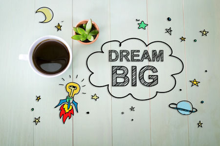 dreams: Dream Big concept with a cup of coffee on a pastel green wooden table