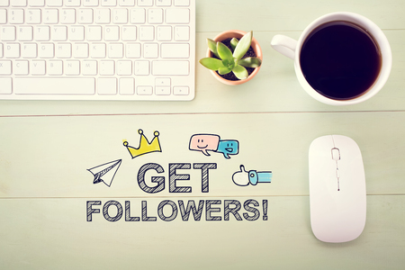 desk light: Get Followers concept with workstation on a light green wooden desk Stock Photo