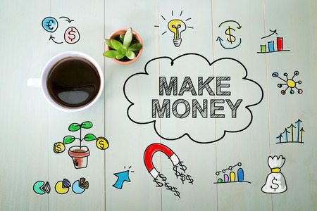 Make Money concept with a cup of coffee on a pastel green wooden table Stock Photo