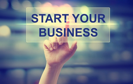 Hand pressing Start Your Business on blurred cityscape background 免版税图像 - 47808059