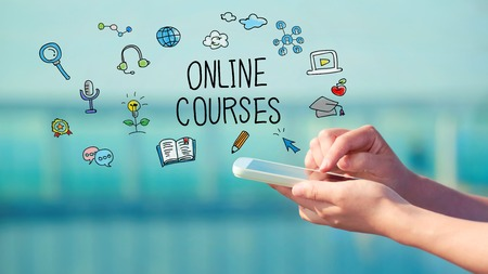 Online Courses concept with person holding a smartphone 스톡 콘텐츠