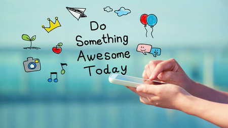 Do Something Awesome Today concept with person holding a smartphone Stock Photo