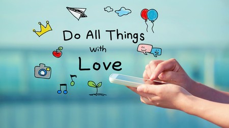 things to do: Do All Things with Love concept with person holding a smartphone