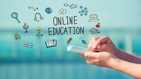smart phone woman: Online Education concept with person holding a smartphone Stock Photo