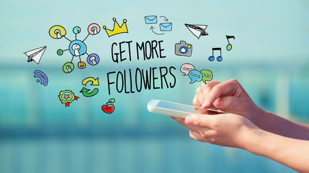 followers: Get More Followers concept with person holding a smartphone Stock Photo