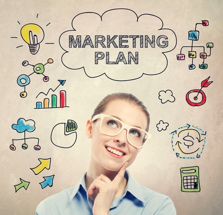 business plan: Marketing Plan concept with young business woman wearing white eyeglasses