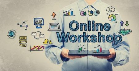 태블릿 컴퓨터를 들고 젊은 남자와 온라인 워크숍 개념