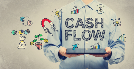 cash flows: Cash Flow concept with young man holding a tablet computer