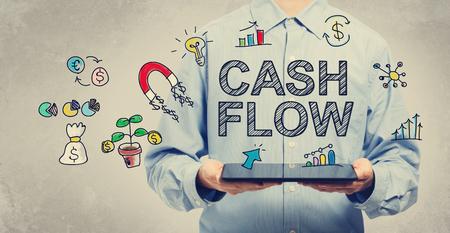 Cash Flow-Konzept mit jungen Mann mit einem Tablet PC Standard-Bild - 48141625